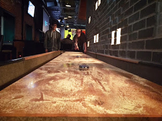 shuffleboard game at kung fu saloon dallas texas