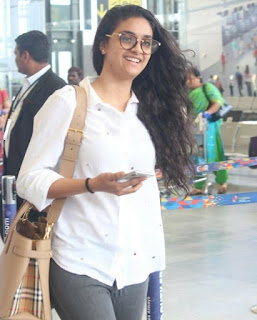 Mana Keerthy Suresh: Keerthy Suresh in White Dress with Cute and Awesome Lovely Smile at Hyderabad Airport