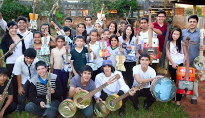 kid and their recycled musical instruments in the landfill harmonic orchestra