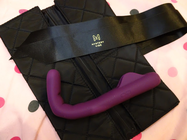 Mysteryvibe Crescendo - purple vibrator, bent, on black casing