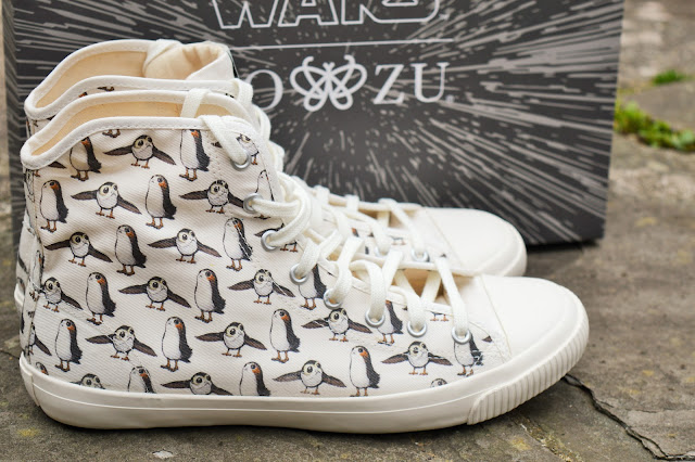 Close up of Star Wars shoes with box behind.