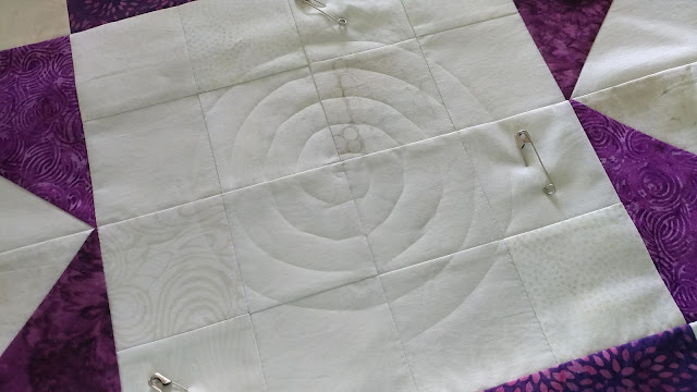 Modern Jacob's Ladder quilt using Island Batik fabrics and spiral walking foot quilting