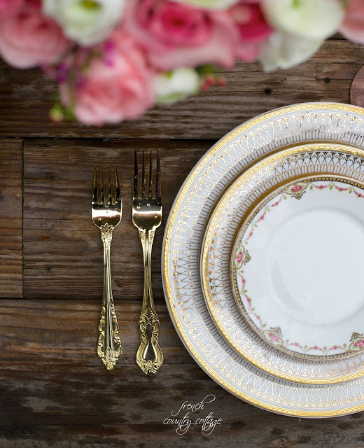 rustic table top with elegant gold china