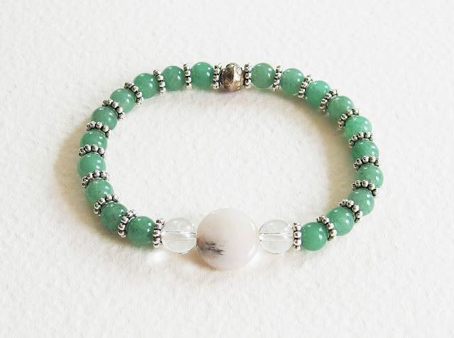 https://www.alittlemarket.com/bracelet/fr_bracelet_precieux_avec_pierres_de_gemme_perles_jade_quartz_rutil_cristal_de_roche_metal_argente_vert_et_blanc_-16309096.html