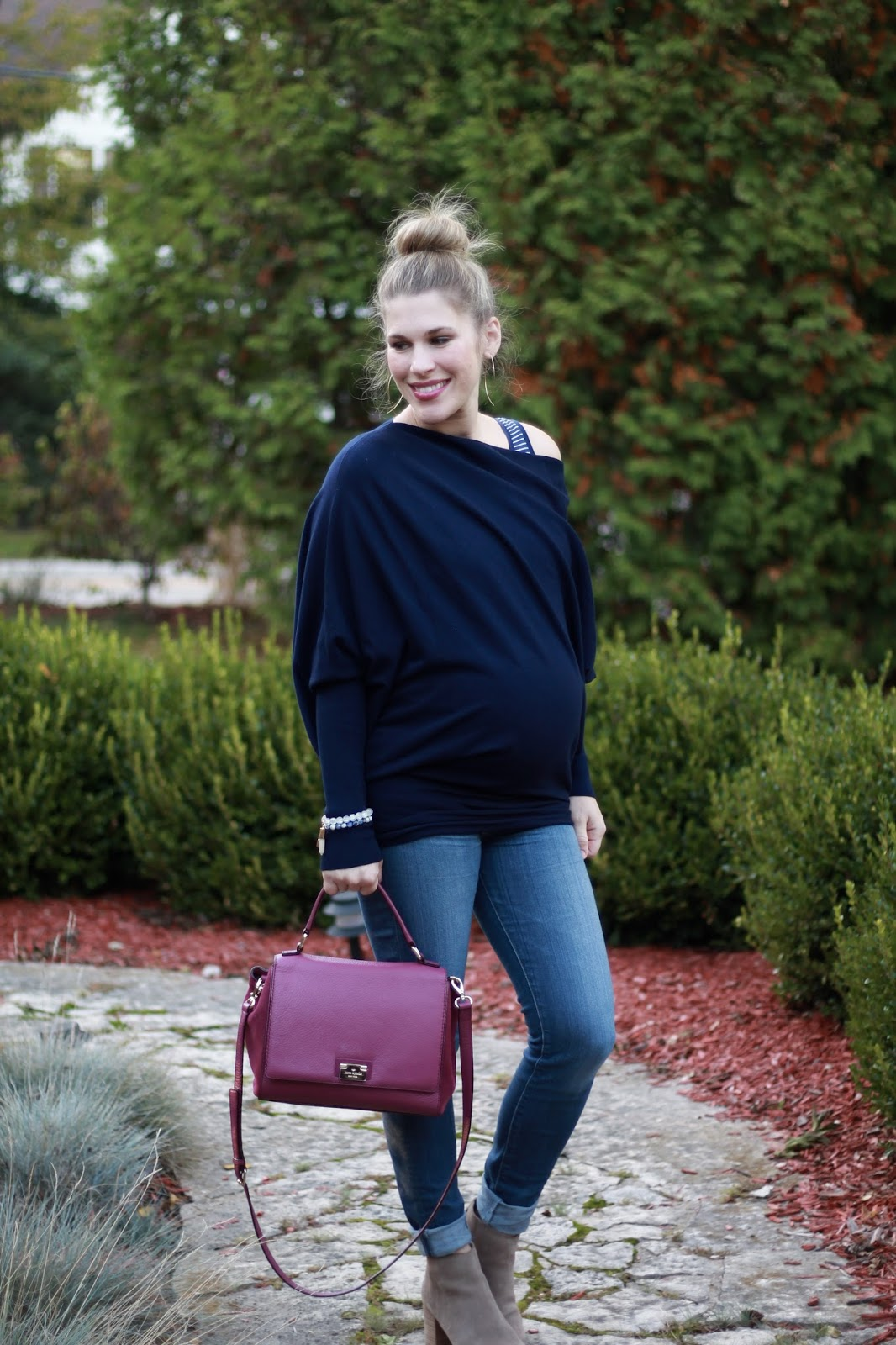 navy off the shoulder sweater, jeans, taupe booties, plum Kate Spade bag