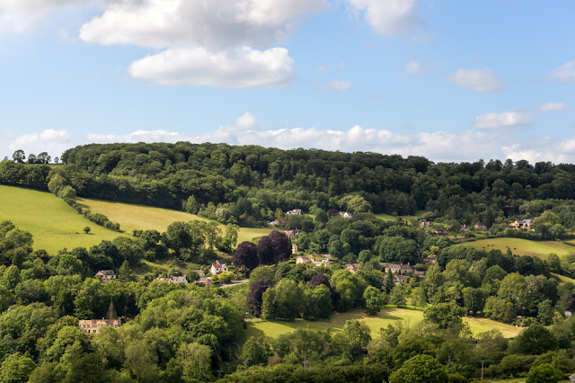 Landscape image of the West Cotswolds and the village of Cranham