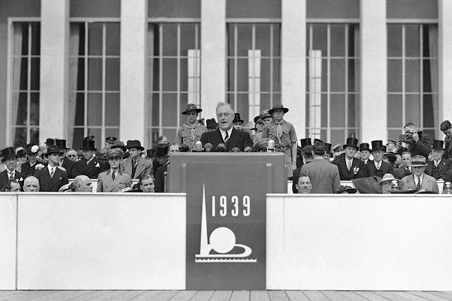 Flanked by Boy Scouts, President Franklin D. Roosevelt opened New York's $160,000,000 World's Fair with an address in which he said America has