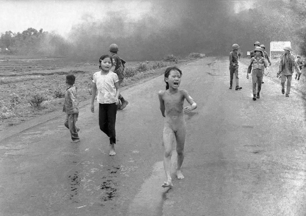 'Napalm girl' Phan Thị Kim Phúc Running from Village to escape the flaming napalm.