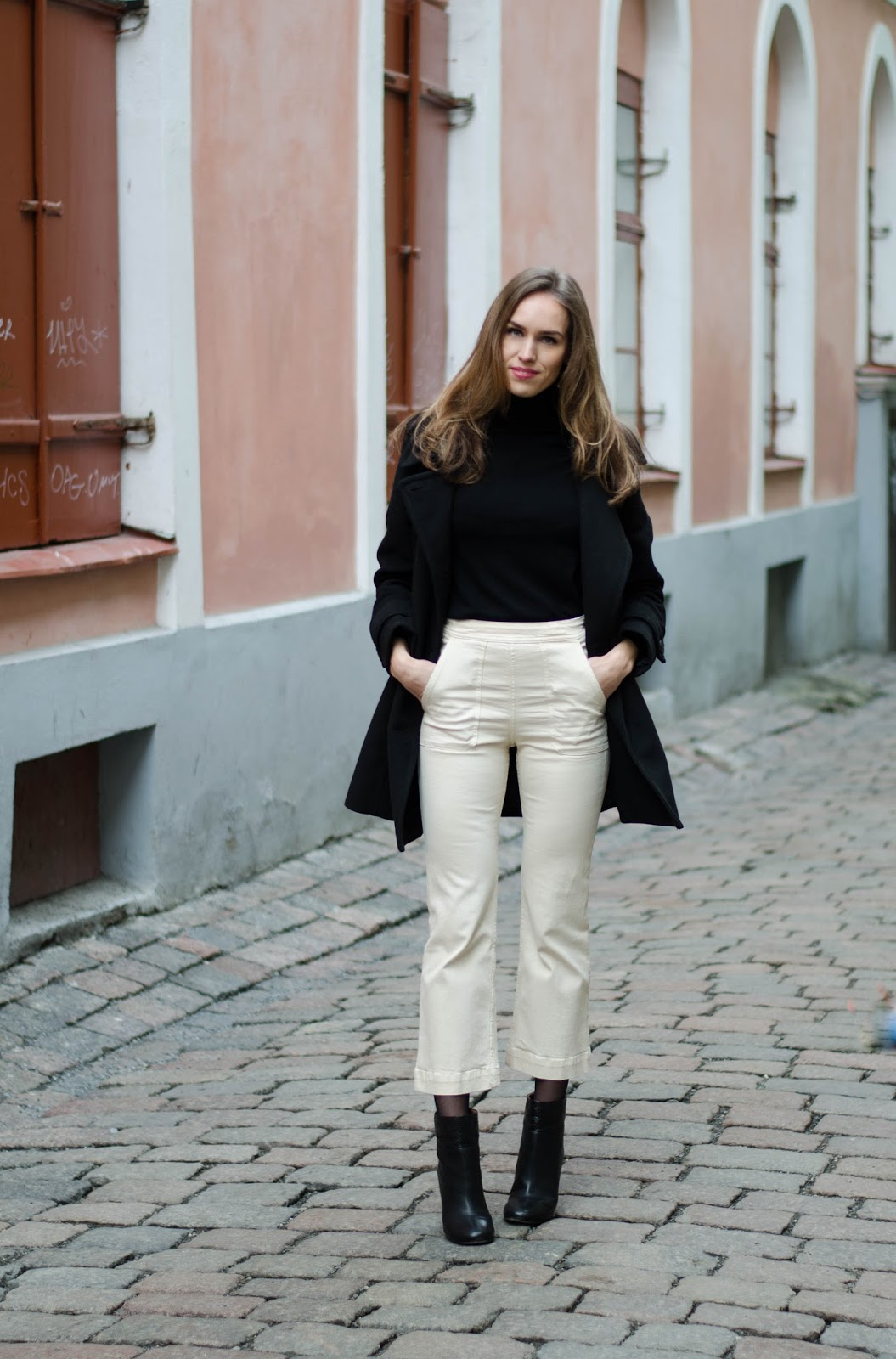 kristjaana mere white kick flare ankle jeans black turtleneck