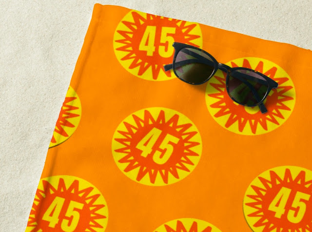 Cool beach towel with scorchio 45 degrees weather badges