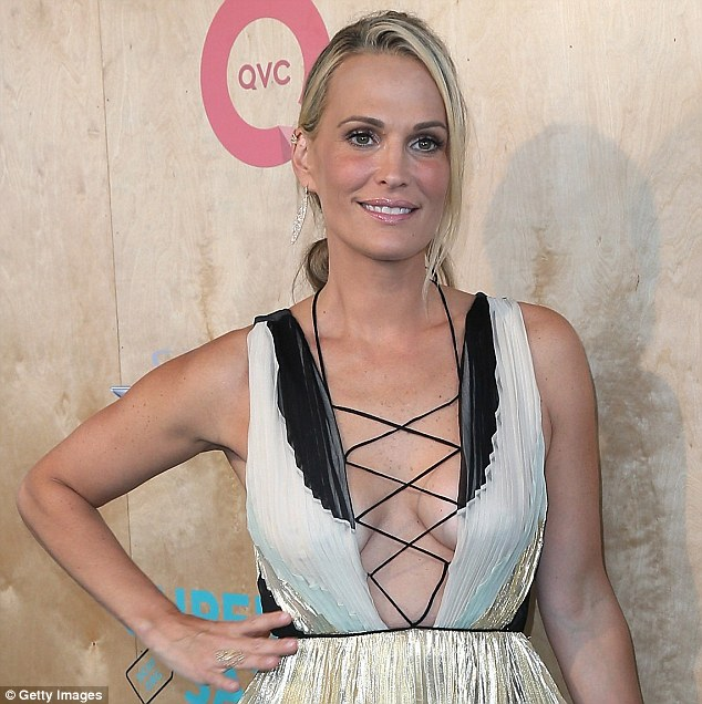 Molly Sims bares cleavage in bohemian dress at charity event