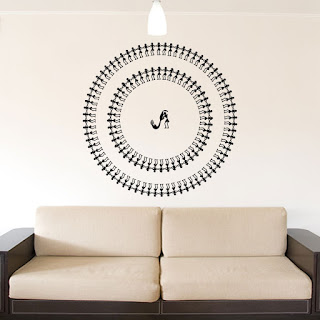 https://www.kcwalldecals.com/ethnic-indian/647-circular-warli-tarpa-dance-wall-decal.html?search_query=Warli&results=19