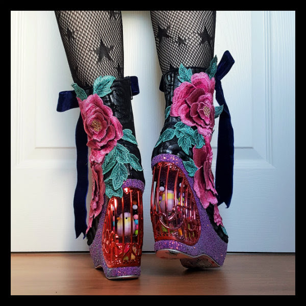 back view wearing Irregular Choice Maya boots with birdcage concept heel