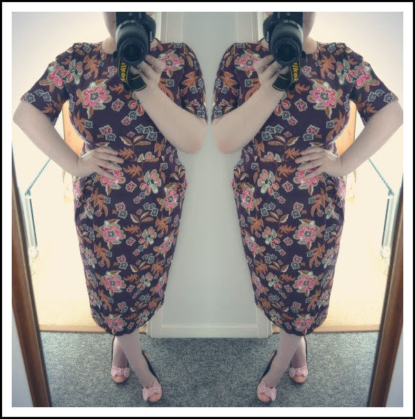 plus size blogger wearing floral dress and Irregular Choice peach bow shoes