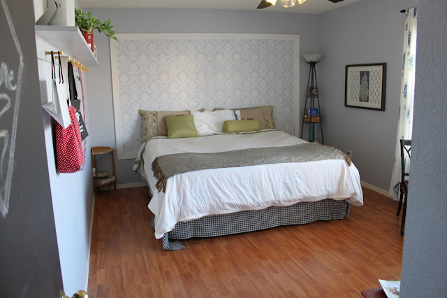blue bedroom with a matching wallpaper headboard