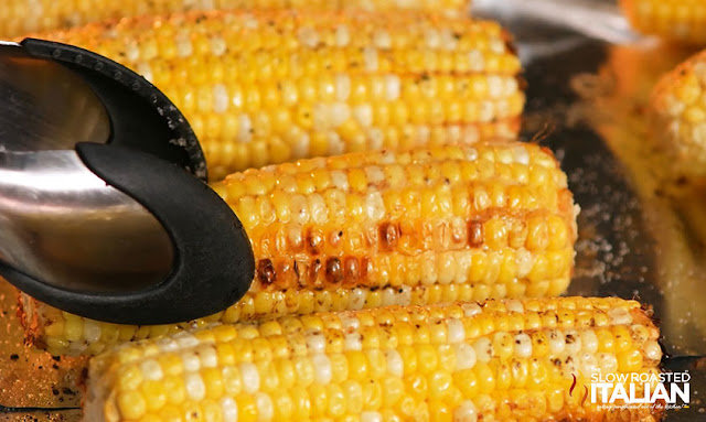 Corn on the Cob in the Oven: Turn the corn with tongs
