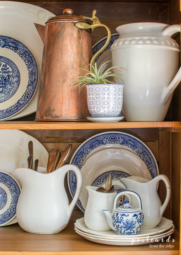 blue and white dishes with copper accents
