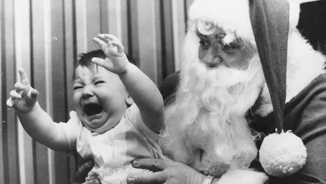 Baby cries and reaches for parent while sitting on Santa's lap. c.1960s A Pleasant Christmas Story and other stories of Christmas Creepers. marchmatron.com