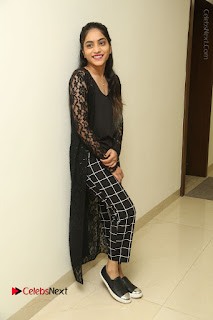 Actress Punarnavi Bhupalam Stills in Black Dress at Pittagoda Press Meet  0129.JPG