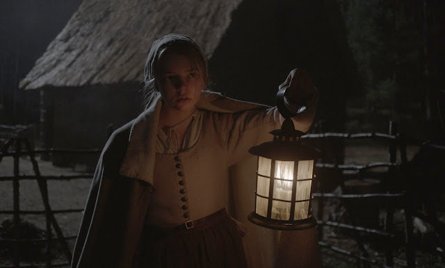 A typically darkly lit image from the film
