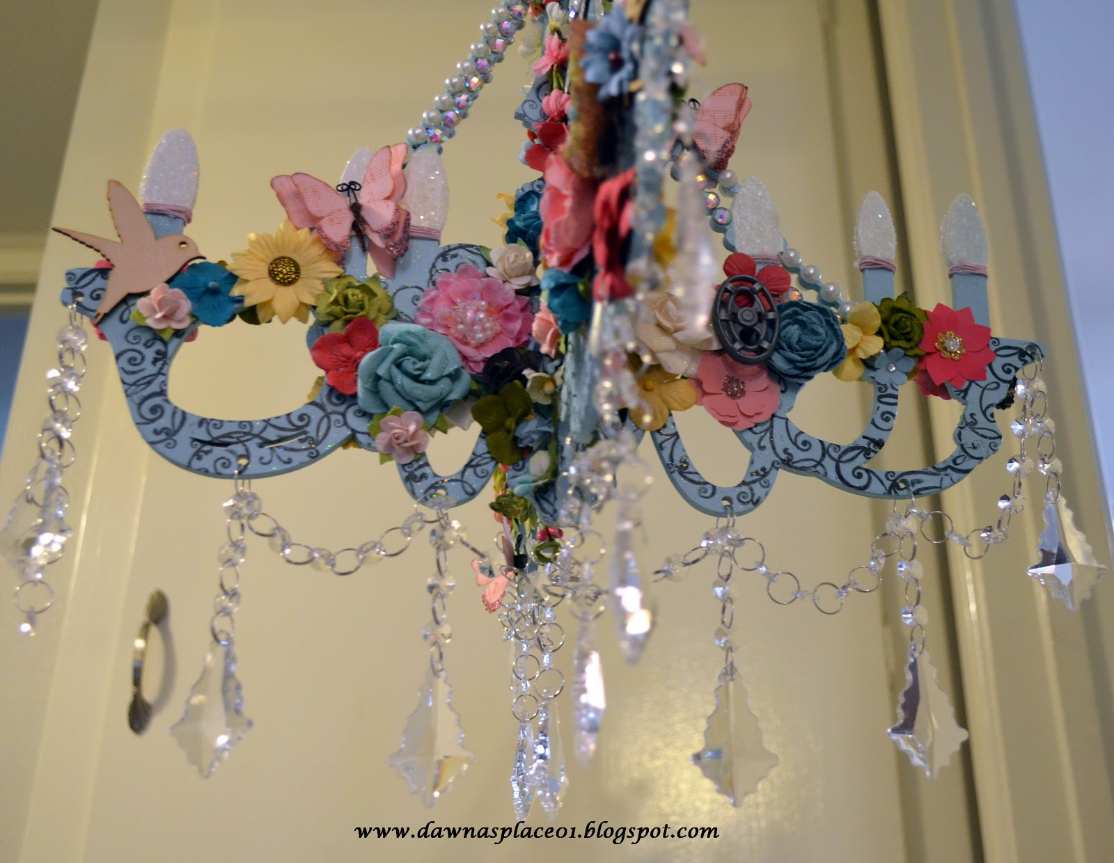 Dawnas place dream garden chandelier i decorated each section of the chandelier with flowers and garden themed trinkets like a blessed water spigot vintage garden hose knob birds nest arubaitofo Gallery