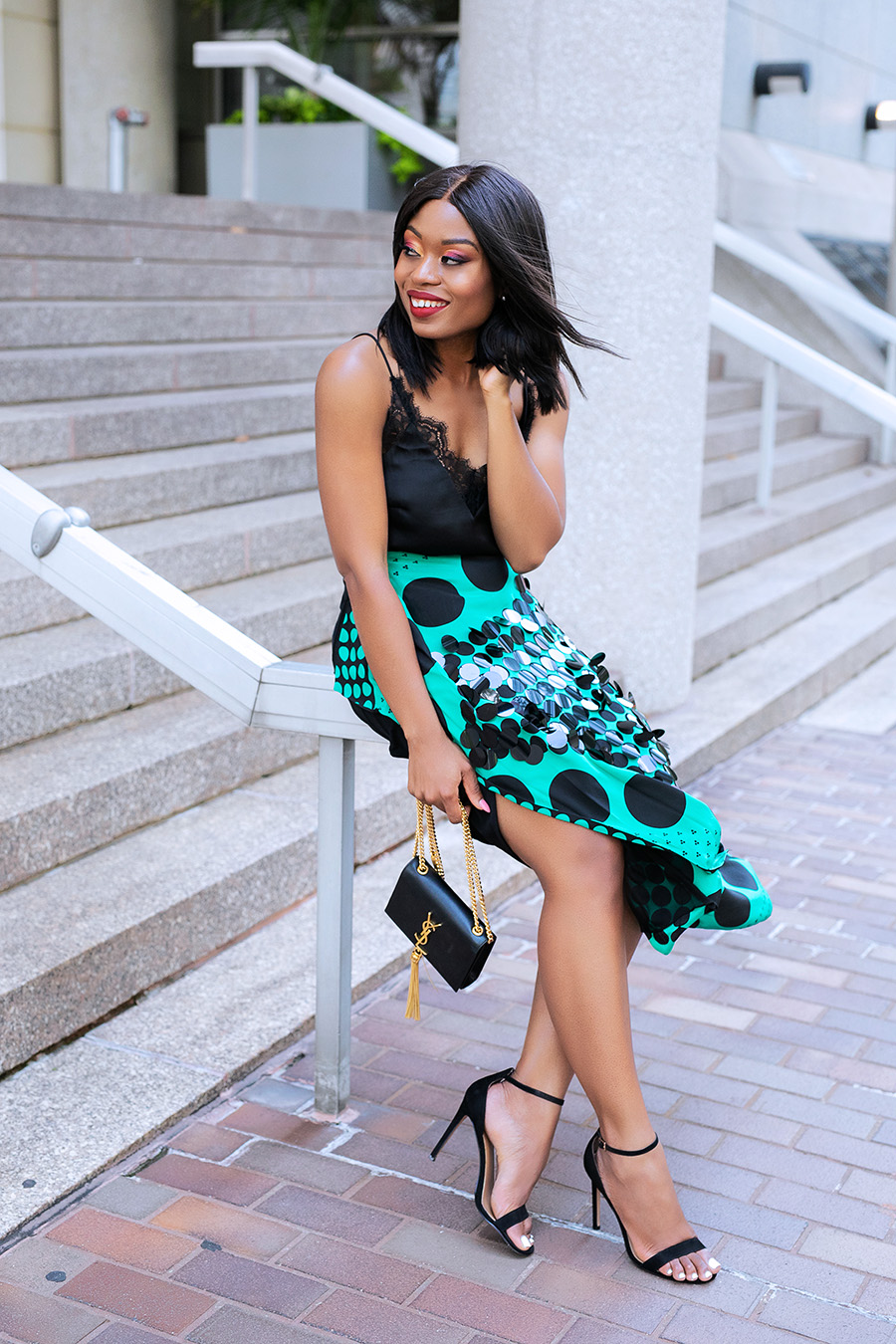 Stella-adewunmi-of-jadore-fashion-Holiday-outfit-in-DVF-embellished-midi-skirt-lace-cami