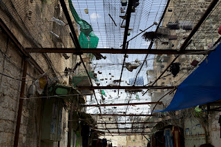 garbage thrown on shops in Hebron old city