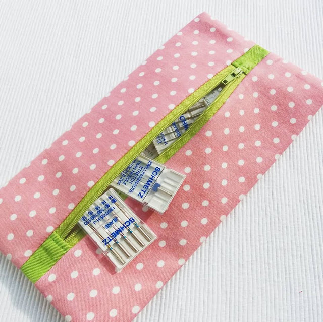 Learn how to make a small zippered pouch for sewing notions - flat and with a centred zip. Tutorial by Apple Green Cottage