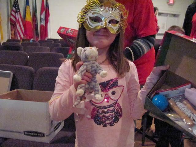 Kids packing Operation Christmas Child Shoeboxes.