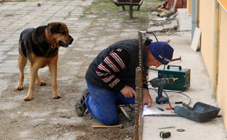 Bekir welding while Rambo watches on