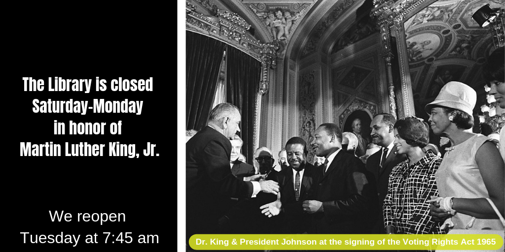 Dr. King and President Johnson shake hands at the signing of the Voting Rights Act, 1965