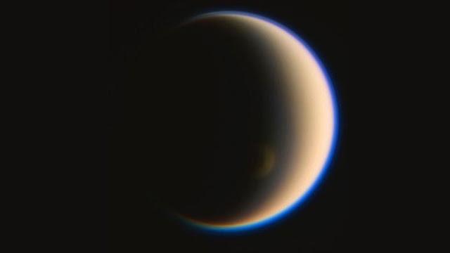 Unexpected atmospheric vortex behaviour on Saturn's moon Titan