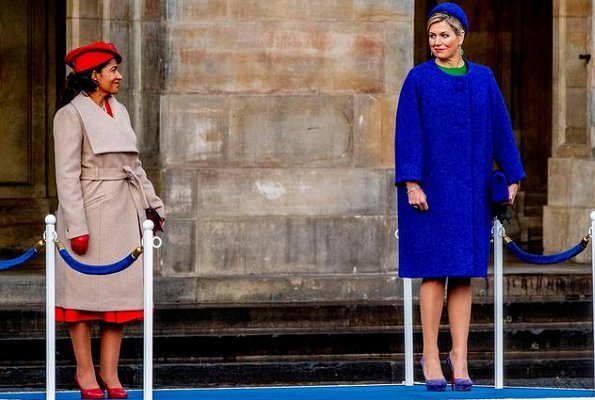 Queen Maxima wore Natan coat from Fall Winter collection and Natan green dress. First Lady Lígia Dias Fonseca