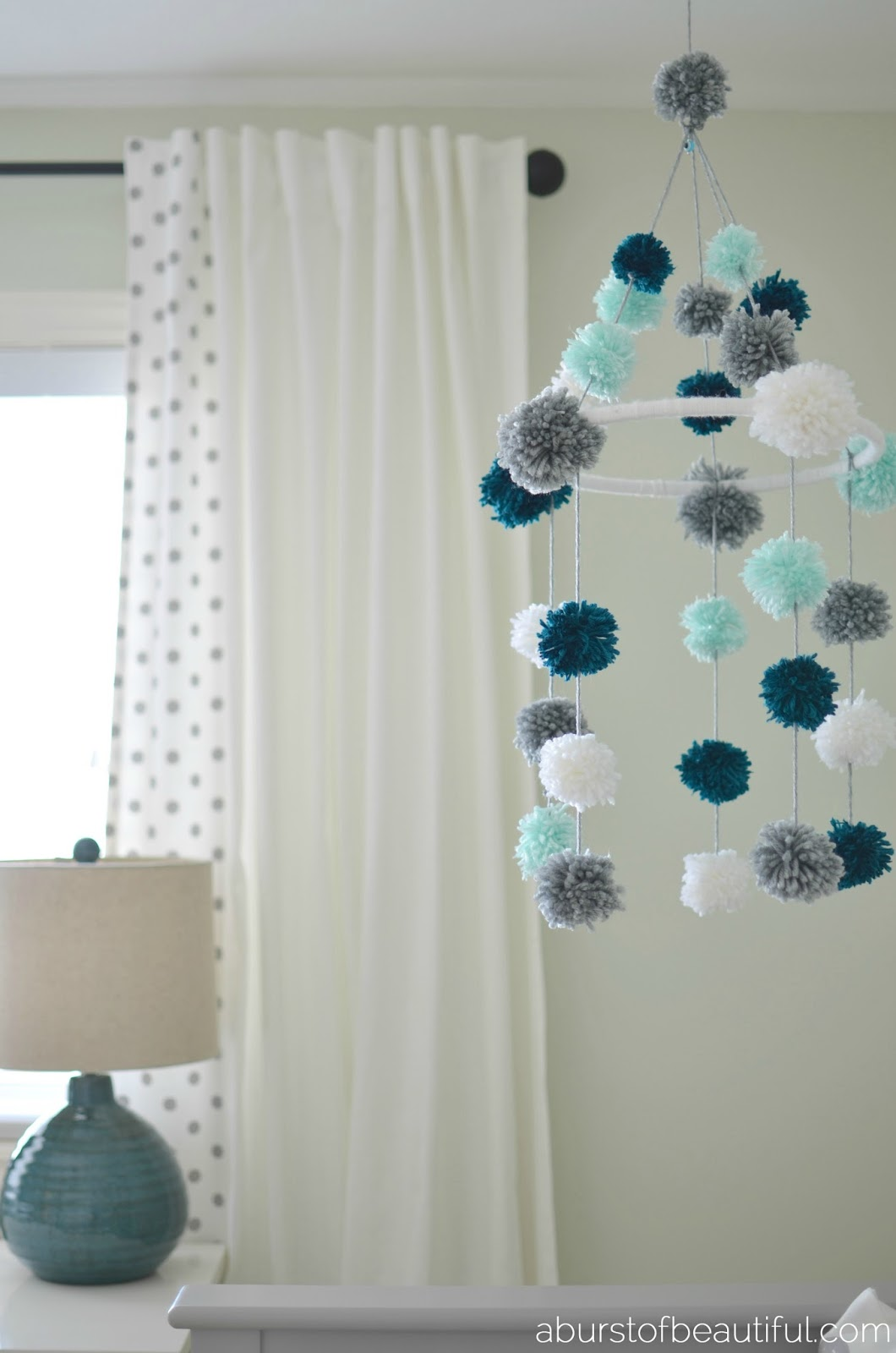 diy pom pom mobile a burst of beautiful. Black Bedroom Furniture Sets. Home Design Ideas