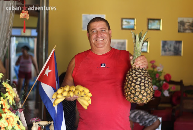 A man shows the fresh fruit he offers his guests at his private guesthouse in Baracoa, Cuba