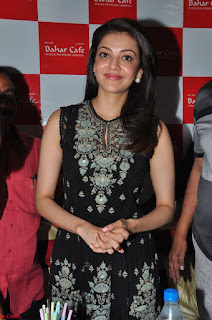 Kajal Aggarwal in lovely Black Sleeveless Anarlaki Dress in Hyderabad at Launch of Bahar Cafe at Madinaguda 018.JPG