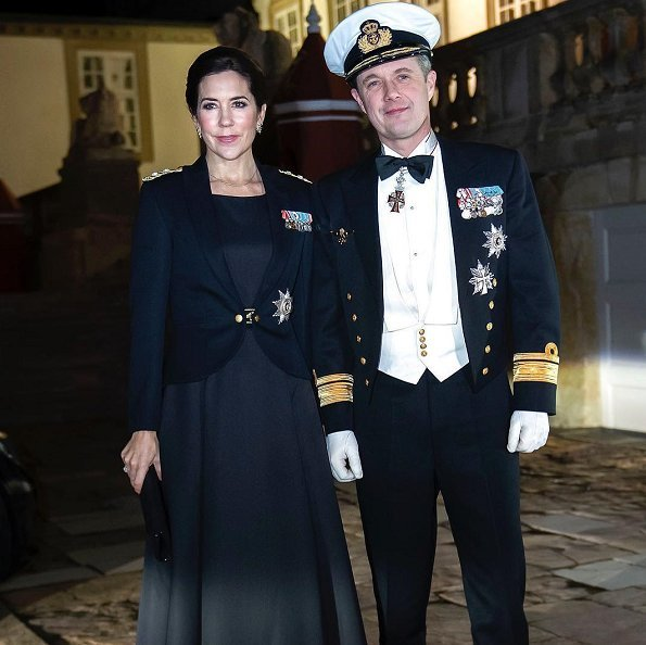 Crown Princess Mary is wearing a tailored jacket honoring the Navy officers. Crown Prince Frederik attended the dinner