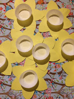 Cup cake cases glued to the centre of the yellow daffodil cut outs