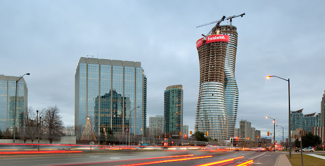 Photo of towers under construction and the traffic as seen from the street