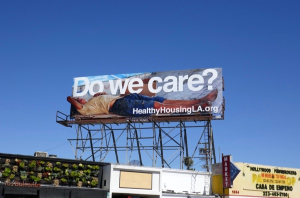 Do we care homeless child billboard