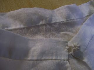 Collar and thread button close up, repro 16th century smock.