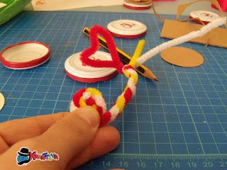 cuore con fili di ciniglia