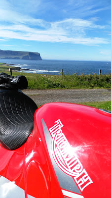 Isle of Hoy across from Orkney, seen from above a Triumph petrol tank.