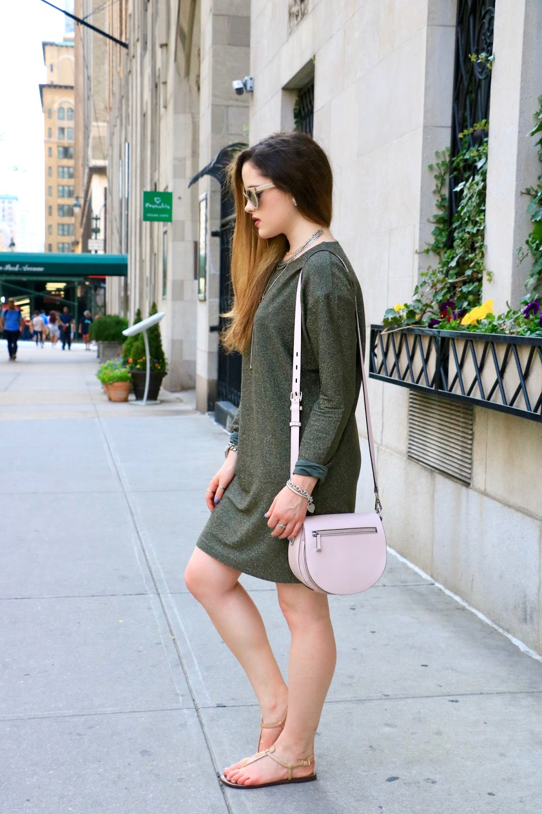Fashion blogger Kathleen Harper wearing an open-back sweatshirt dress