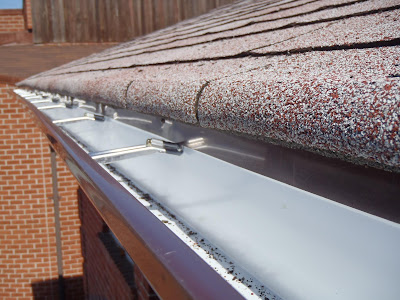 Flashing installed to prevent water going behind eavestrough GTA
