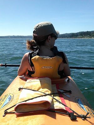 Artist on vacation, kayaking in Washington state.