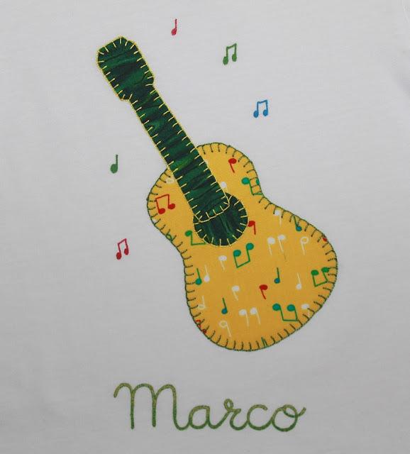 camiseta y cubrepañal bebe musica guitarra
