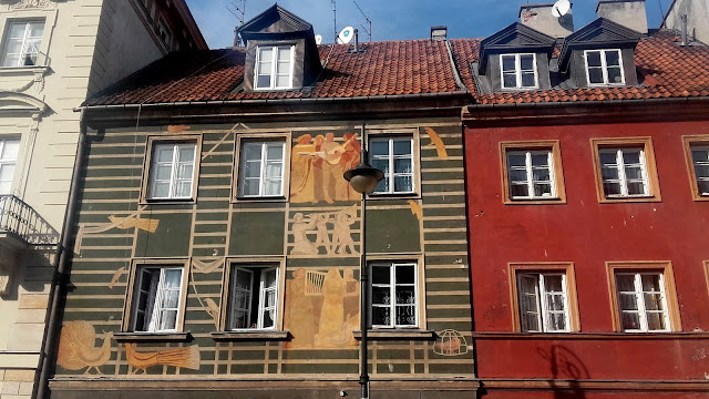 Beautiful painted building in Warsaw city center