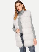 https://fr.shein.com/Paneled-Faux-Fur-Vest-p-592581-cat-1735.html