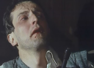 Screenshot from Spy! Episode 2 - Camp 020 - BBC - 1980 Wulf Schmidt being roughed up by the Commandant.